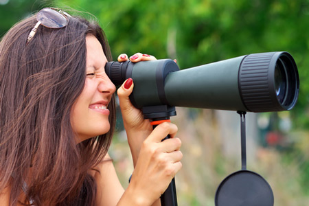 girl using a spotting scope