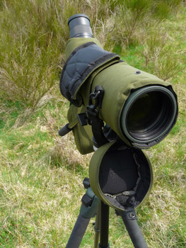 spotting scope in camouflage cover