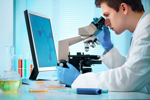 scientist-in-lab-with-microscope
