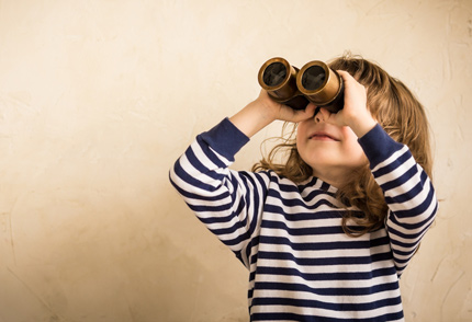 Child-exploring-with-binoculars
